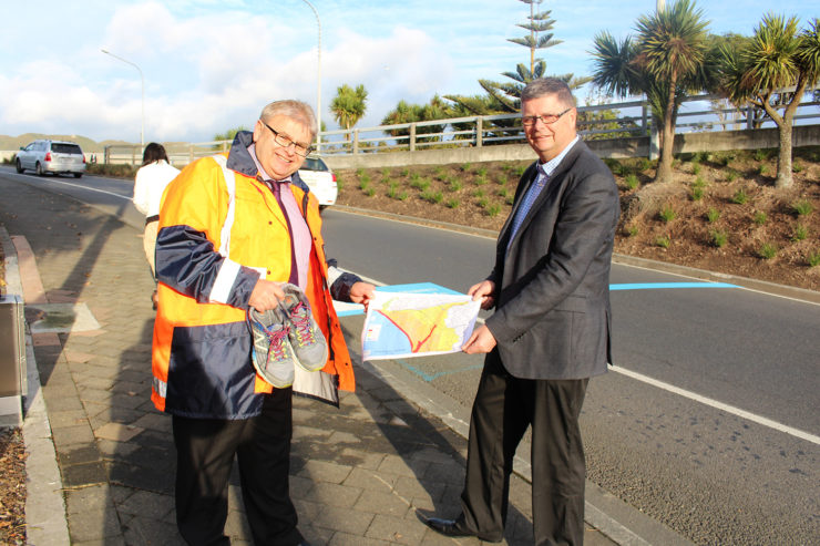 Mayor Wallace and Divisional Manager of Regulatory Services, Geoff Stuart with a map of Tsunami zones.