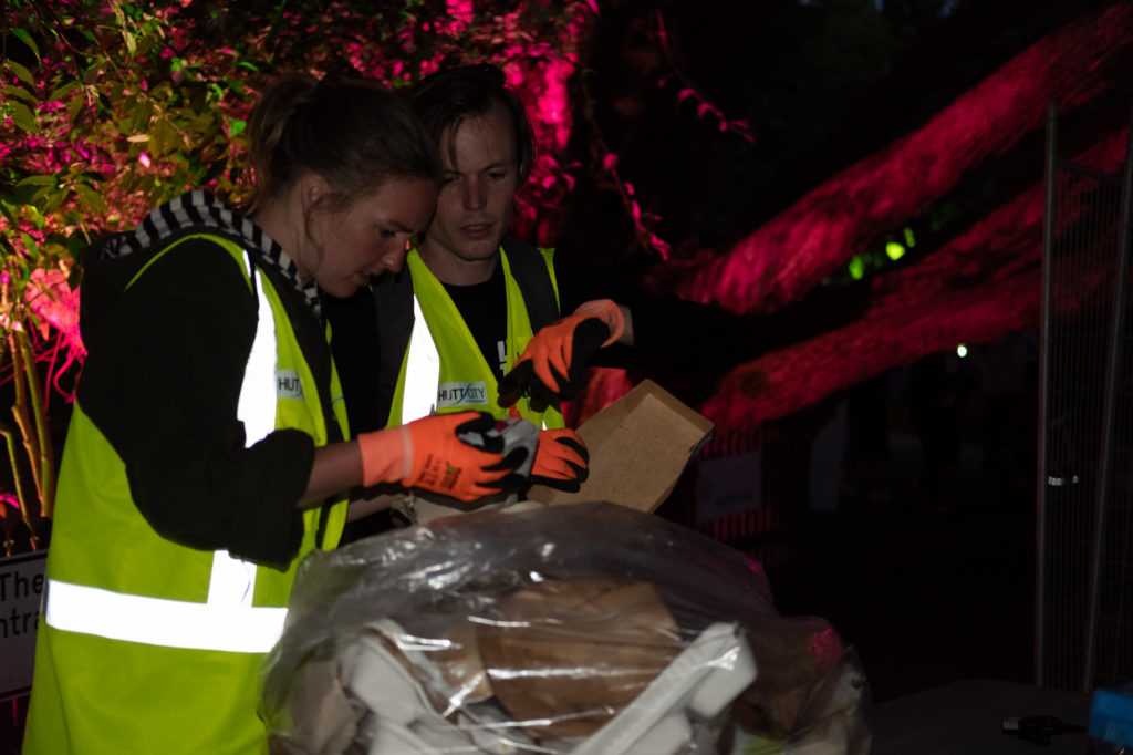 Volunteers sorting rubbish and recycling at HighLight: Carnival of Lights