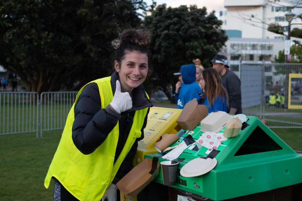 A volunteer ensuring people at HighLight: Carnival of Lights dispose of their rubbish in the correct bins