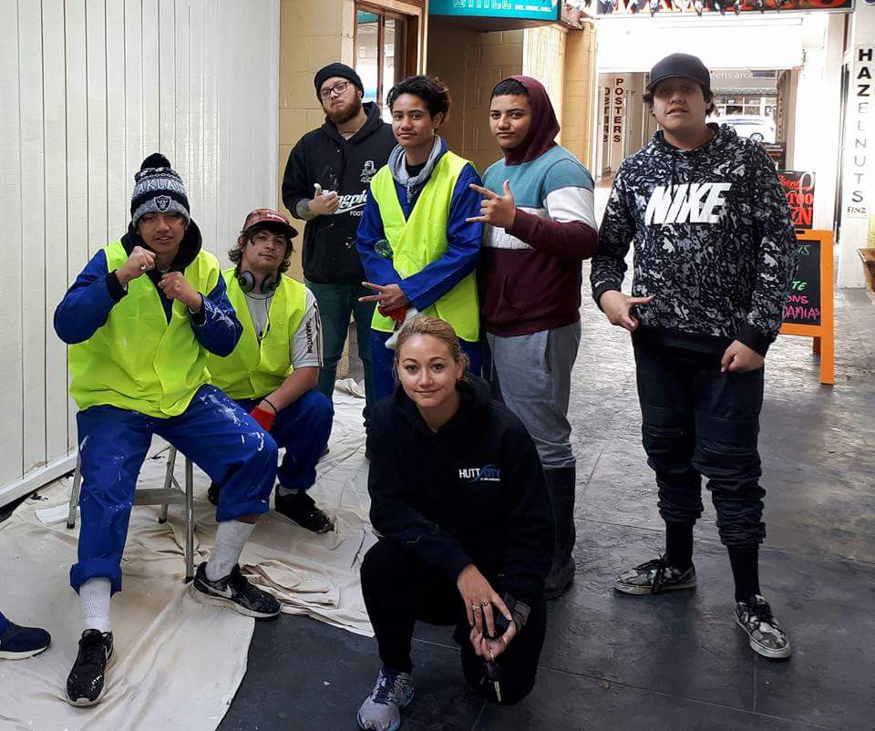 Hutt City Council's Mel Gardner with the artists and youth volunteers who completed the Queens Arcade mural