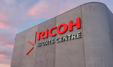 Ricoh Sports Centre sign just after dawn