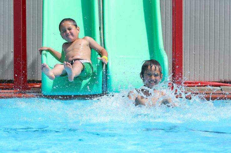 Kids on the slide at Wainuiomata Summer Pool