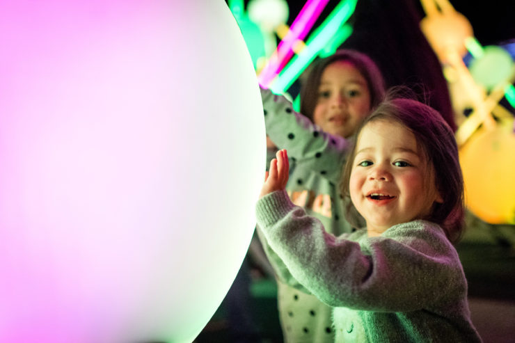 Little girl touches glowing ball
