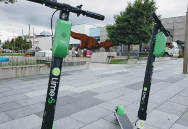 Two lime scooters outside The Dowse Art Museum