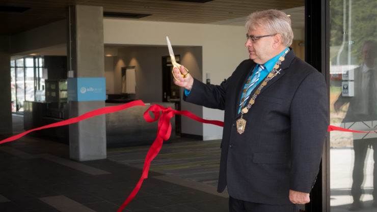 Mayor Ray Wallace cuts the ribbon to the new Ricoh Sports Centre
