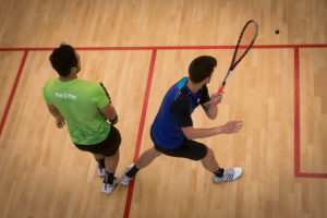 Champion Squash Players Scott Galloway (in green) and Evan Williams (in blue) play a game of Squash at the new Ricoh Sports Centre