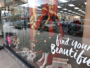 Window display Christmas tree with mannequin arms and legs attached