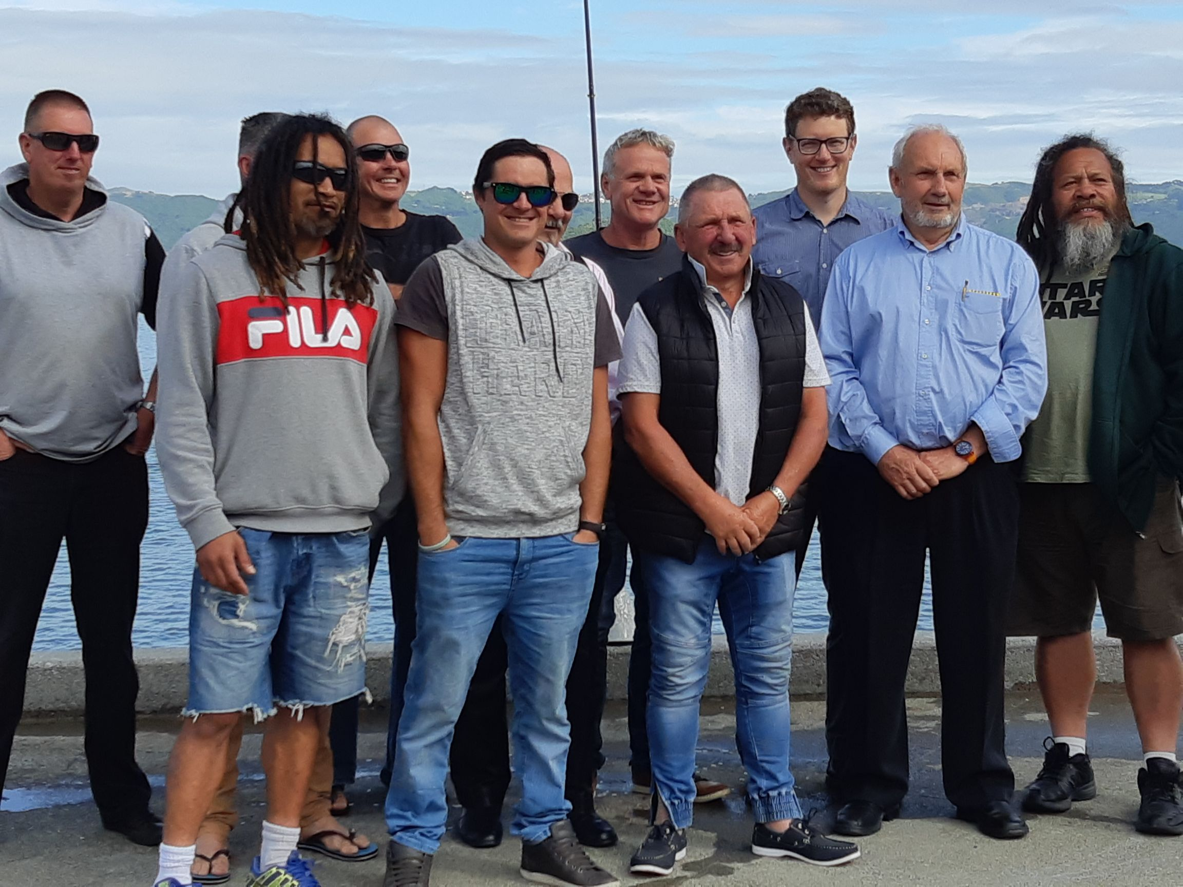 Some of the contractors involved in the Rona Bay Wharf refurbishment — at Rona Bay, Eastbourne, NZ.