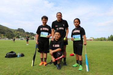 Lara Andrews with Te Aroha players and their player of the day vouchers
