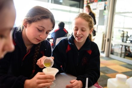 Young women do a science experiment in the classroom
