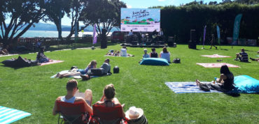 People at an event looking at large screen displaying 'Lower Hutt, proud to be smokefree'