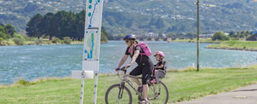 Mum and daughter bicycle along Hutt River Trail
