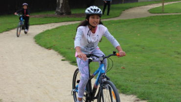 Child on bicycle on pump track