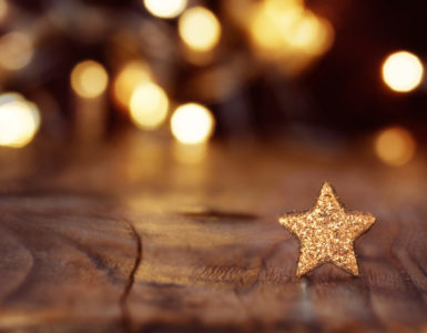 Festive shining Christmas background with stars and bokeh