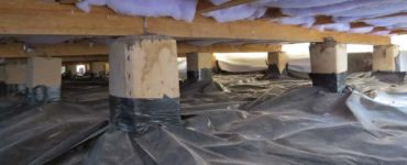 a ground moisture barrier underneath a house