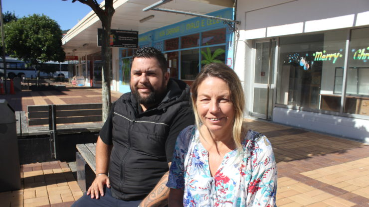 Henare Parker and Kathy Douds sit outside