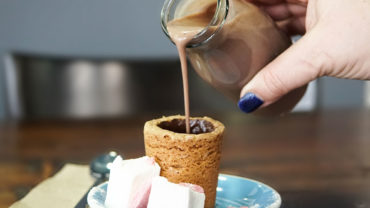 Hot chocolate poured into biscuit cup