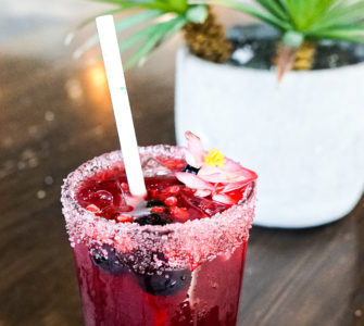 Red berry drink in a tall glass
