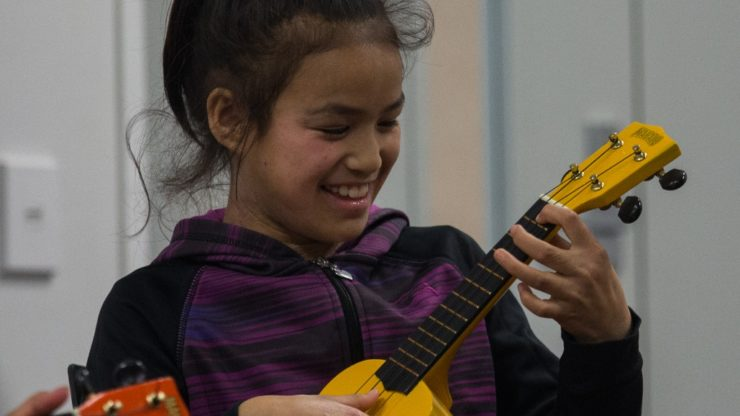 Young girl plays the guitar