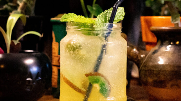 Chilled drink in jar with mint leaves and straw