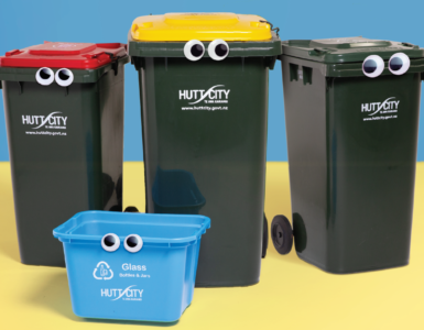 3 wheelie bins and blue recycling crate, all with googley eyes