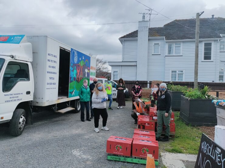 Photo of Hutt City Council Volunteers helping unload a truck of food deliveries.