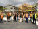 Projects partners stand in front of the Takai Here Tāngata development in Taita, Lower Hutt.